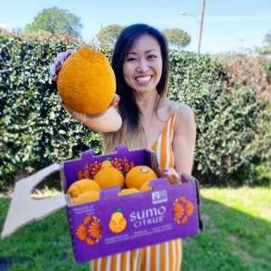 Influencer holding a box of Sumo Citrus