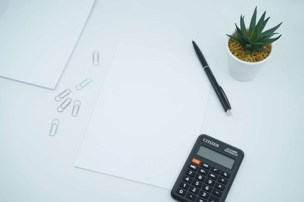 Calculator with blank paper and pen